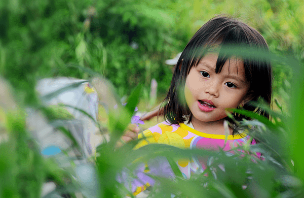 header-get-involved girl in grassy field